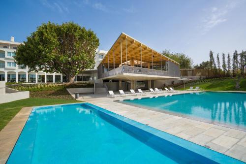 A piscina em ou perto de OZADI Tavira Hotel