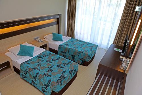 Кровать или кровати в номере Cimen Hotel