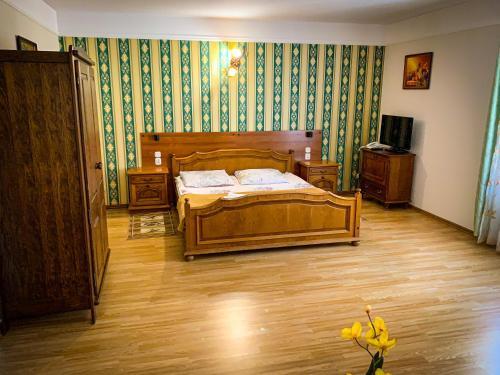 Łóżko lub łóżka w pokoju w obiekcie Hotel Wellness & SPA Antyczny Dwór