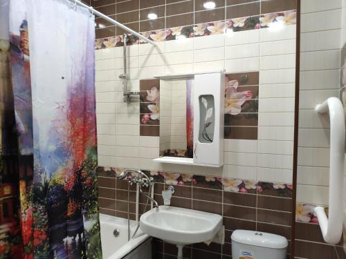 Ванная комната в Apartament On Olimpiyskaya 85