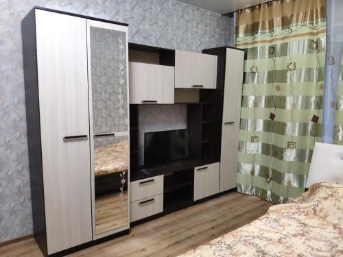 Телевизор и/или развлекательный центр в Apartament On Olimpiyskaya 85