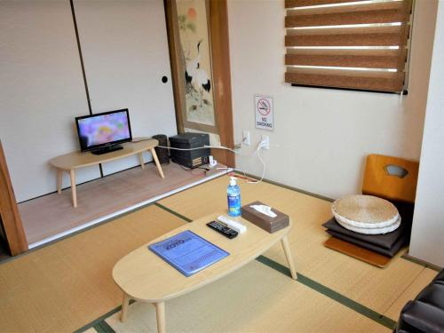 A television and/or entertainment center at Stay Inn KOTO
