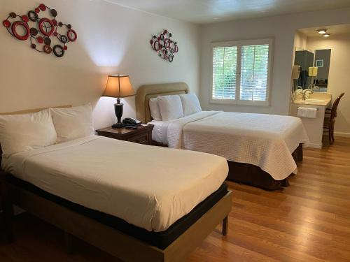A bed or beds in a room at Carmel Resort Inn