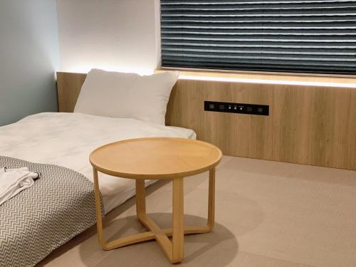 A bed or beds in a room at THE TOURIST HOTEL & Cafe AKIHABARA