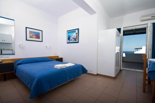 A bed or beds in a room at Vrahia Studios
