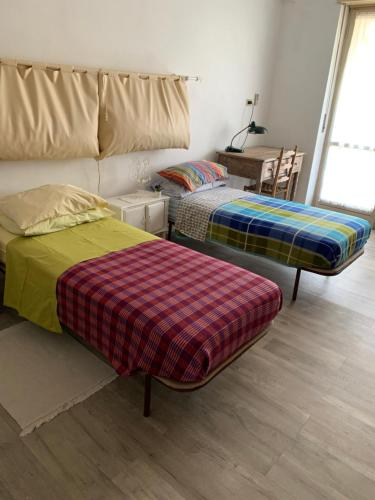 A bed or beds in a room at Appartamento luminoso