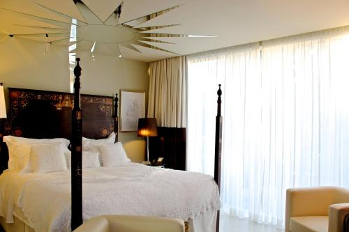 A bed or beds in a room at Carmo's Boutique Hotel - Small Luxury Hotels of the World