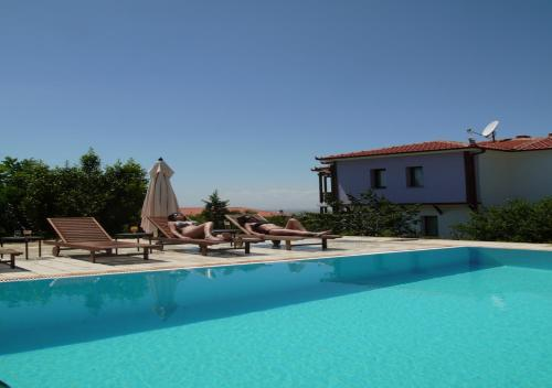 The swimming pool at or close to Roxani Country House Resort