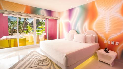 A bed or beds in a room at Temptation Cancun Resort - All Inclusive - Adults Only