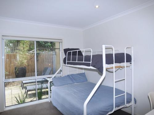 A bunk bed or bunk beds in a room at SANDPIPER 3 - CLOSE TO BEACH AND TOWN