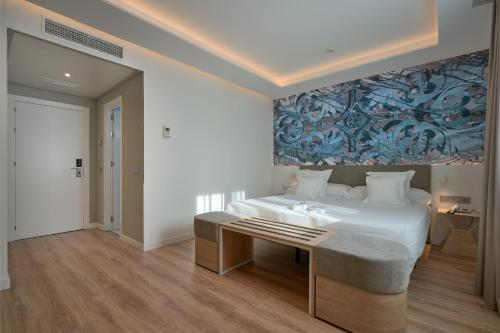 A bed or beds in a room at Monte Triana
