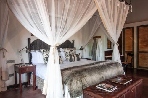 A bed or beds in a room at Jock Safari Lodge