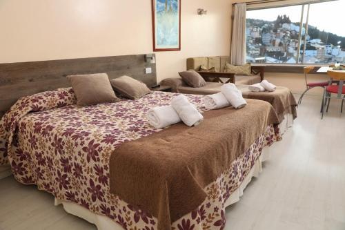 Una cama o camas en una habitación de Bariloche Center 630 STUDIO