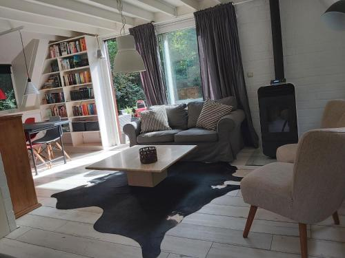 A seating area at 2 bedroom holiday home Rekem