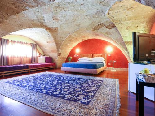 Un ou plusieurs lits dans un hébergement de l'établissement Monteforte Resort