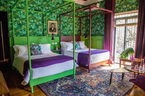 A bed or beds in a room at Pug Seal Polanco Anatole France Curamoria Collection