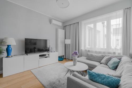 Część wypoczynkowa w obiekcie Unit Apartment Deluxe Warszawa Centrum Plac Zbawiciela Hala Koszyki