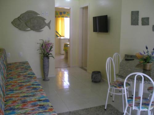 A television and/or entertainment center at Apartamento Meia Preia