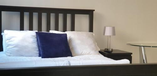 A bed or beds in a room at Maidstone Tower View Apartment