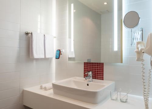 Ванная комната в Park Inn by Radisson Volgograd Hotel