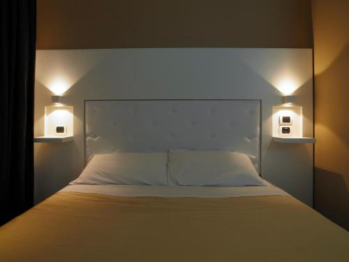 A bed or beds in a room at Jazz Style
