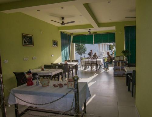 A restaurant or other place to eat at Sanctuary Tourist Lodge