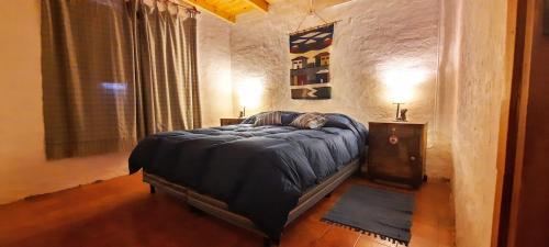 Una cama o camas en una habitación de Aire de Barreal Hostel Andino