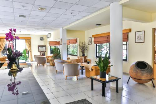 The lobby or reception area at Tavros Hotel Apartments