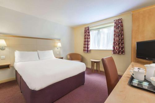 A bed or beds in a room at Days Inn Winchester