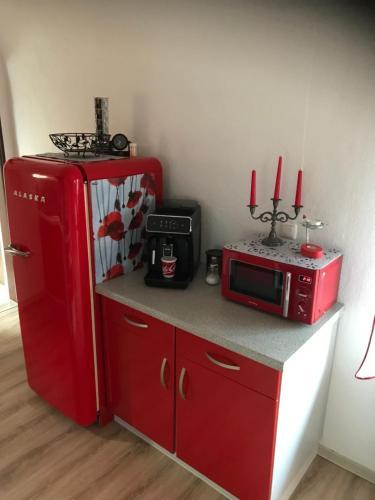 A kitchen or kitchenette at Beti Apartment