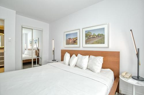A bed or beds in a room at Town Inn Suites