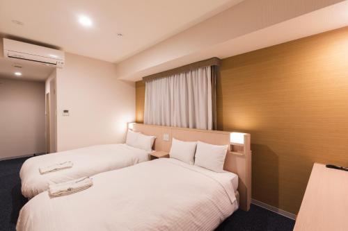 京都四條鳥丸索特圖斯弗雷撒酒店房間的床