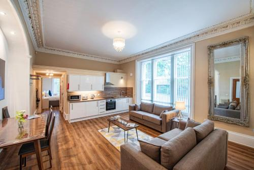 A kitchen or kitchenette at Rosedene Highland House Apartments, Central Inverness