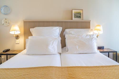 Cama o camas de una habitación en Memmo Alfama - Design Hotels