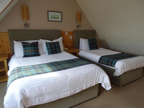 A bed or beds in a room at The Sands Hotel, Orkney