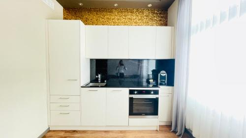 A kitchen or kitchenette at Plaza Hotel Winterthur