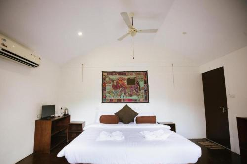 A bed or beds in a room at The Village Agonda