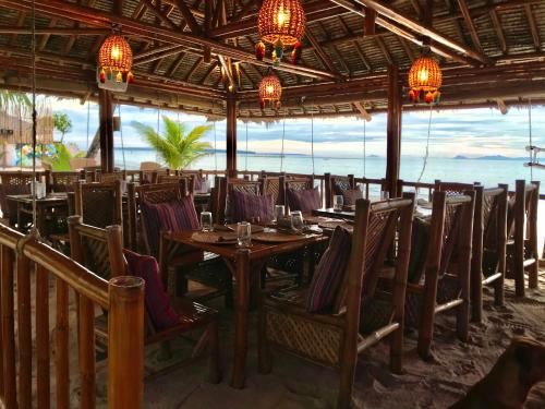 A restaurant or other place to eat at Amihan Beach Cabanas