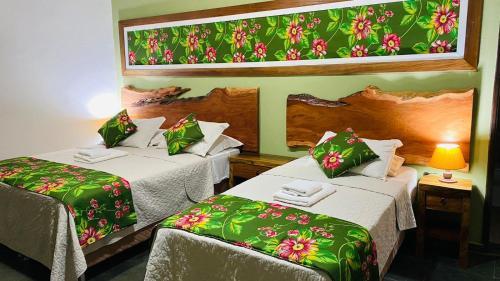 A bed or beds in a room at Hotel Fazenda Santa Tereza