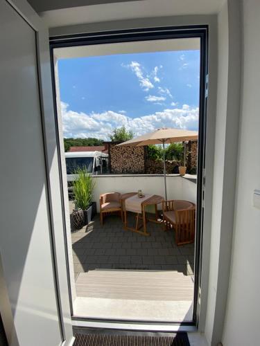 Ein Balkon oder eine Terrasse in der Unterkunft Schwarzwald Boutique-Apartment HAUS REHGARTEN