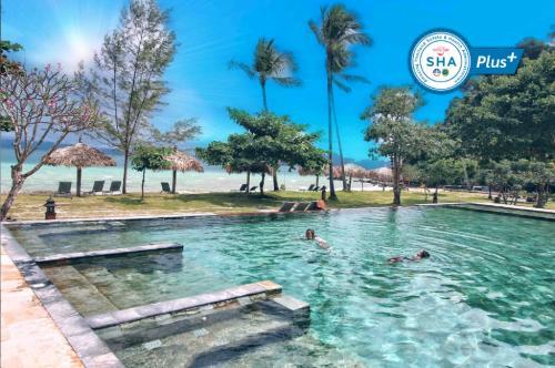 The swimming pool at or near Thanya Beach Resort - SHA Plus