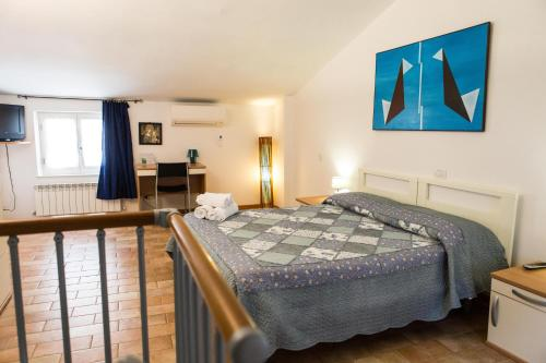 A bed or beds in a room at GH Paradiso - Apartments
