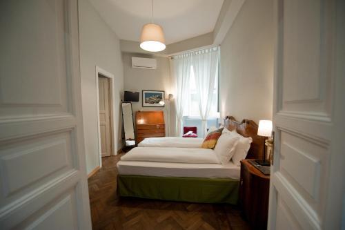 Кровать или кровати в номере Cassiodoro19