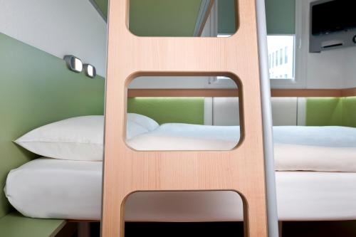 A bunk bed or bunk beds in a room at Ibis budget Koeln Messe