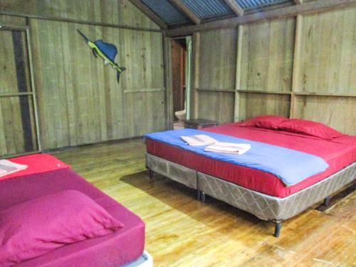 Cama ou camas em um quarto em Hotel Kangaroo Rio Dulce
