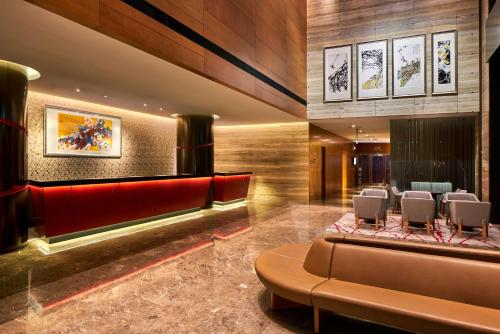 The lobby or reception area at Ramada by Wyndham Singapore at Zhongshan Park (SG Clean)