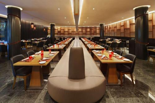 A restaurant or other place to eat at Ramada by Wyndham Singapore at Zhongshan Park (SG Clean)