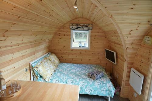 A bed or beds in a room at The Piggery Pod