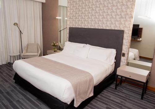 Cama o camas de una habitación en MDS Hotel Concepción