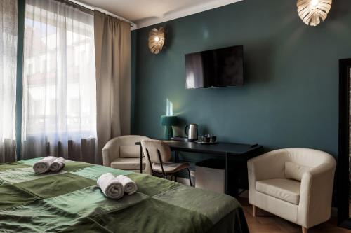 TV a/nebo společenská místnost v ubytování Louren Apartments Charles Bridge